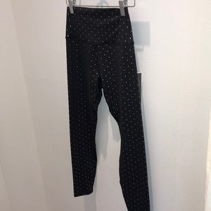 Black leggings with rose gold polka dots